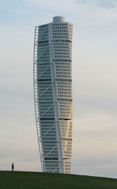 "Malmo, Sweden: Don't miss architect Santiago Calatrava's spectacular apartment building in the Western Harbour. At 190 metres, Turning Torso is the tallest building in Sweden. The building was inspired by a sculpture ""Turning Torso"" by Calatrava himself. Turning Torso consists of nine cubes with a total of 54 stories, with a 90° twist from base to top. The top two floors boast the exclusive meeting rooms of Turning Torso Meetings."