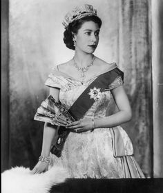 Queen Elizabeth II in Jan 1955 wearing a diamond and pearl tiara worn by Queens of England since Queen Victoria