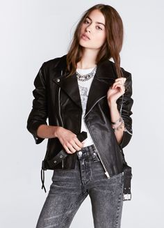 """Leather jacket with traditional biker jacket collar, metal zip pockets, waist belt and silver metal hardware. Relaxed fit. Fully lined with rayon voile.     By Stolen Girlfirends Club  100% Goat Leather  18"""" length  Model is wearing size 2"""