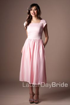 Cheyenne ~ This modest bridesmaid gown has a full a-line skirt and a wide waist band under the bustline.