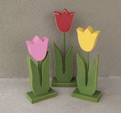 * Set of 3 tall standing tulips painted in red, pink, and yellow with a dowel and base.    * The perfect addition to your Spring decor, home decor.
