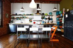 coolest kitchen! love the industrial style mixed with modern