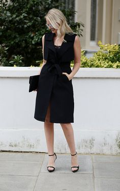 sleeveless trench worn as a dress