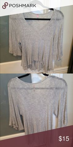 Bell sleeve, hi-lo top FITS BUST: 34, waist: 28 Slightly sheer, quarter length bell sleeve, hi-lo.  NEGOTIABLE; please use the offer feature. Tops