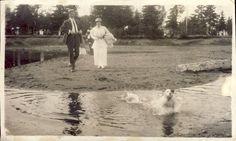 EDWARDIAN Couple Chase Their PUPPY Dog Through WATER Photo Postcard Port Arthur Ontario c1910