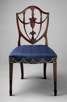 Hepplewhite case back side chair, ca. 1794. Attributed to Samuel McIntyre. Based on plate 2 of Hepplewhite's 'Cabinet Maker and Upholsterer's Guide', it has been enriched with relief carving to legs, grape clusters in the splat lunette, bowknots at tope of legs. Mahogany, ebony, ash, birch, white pine.  http://www.metmuseum.org/toah/works-of-art/62.16
