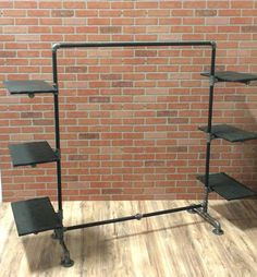 Clothing Rack - Industrial Pipe Clothing Rack with Wood Shelving - Black Pipe Garment Rack This industrial style pipe clothing rack with wood shelving is the perfect addition to an home or retail space! Industrial Pipe, Industrial House, Industrial Style, Vintage Industrial, Industrial Shelving, Vintage Wood, Pipe Furniture, Industrial Furniture, Furniture Stores
