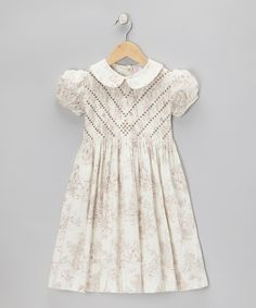 Take a look at this Emily Lacey Tan Toile Chevron Smocked Dress - Infant, Toddler & Girls on zulily today!