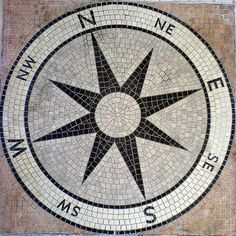 You'll never be lost again with this compass mosaic patio floor!