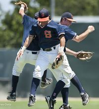 College of the Sequoias' Nick Stoll, left, Christian Gastelum and Ross Feeley celebrate the last out and win over the Oxnard Condors in a JC State baseball championship tournament at John Euless Park on Fresno City Campus on Sunday, May 25, 2014.