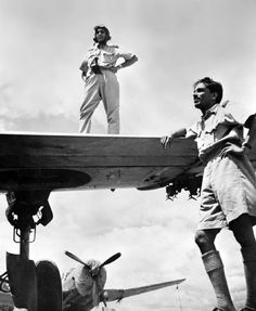 Two Indian Air Force pilots (Flight Lt. Lal and Flying Officer M. M. Sakhre) pose with their U.S. built Vultee A-31 Vengeance dive bombers at an air base from where they attacked the Japanese in Burma (Myanmar) during the Burma Campaign. The IAF played an instrumental role in blocking the advance of the Japanese Army in Burma. It also carried out strike missions against Japanese airbases in the north of Thailand. Assam, India. December 1943.