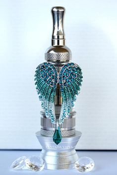 Fantazia Vapes - Emerald Green Angel Wings Tank Vape Charm! The ultimate glamorous charm for your vape! Hand painted, dazzling with sparkles and a hanging genuine Swarovski tear drop crystal!