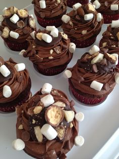 I've been wanting to make rocky road cupcakes for a while and I was just delighted with how these turned out! The cupcake base is soft, chocolatey and fluffy, and several people remarked that the f...