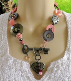 CHARCOAL AND PINK STEAMPUNK BUTTON NECKLACE  $38.50