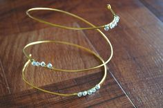 The Classic Crystal Arm Cuff is a quick and easy project that is sure to impress. The gold wire is pretty enough on its own, but the crystal beads are what set this accessory apart.
