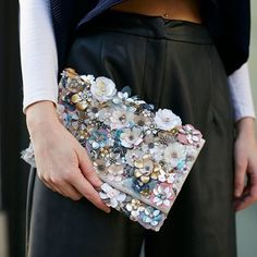 3D flowers, sequins and pastel sparkles. This clutch has spring written all over it! #Accessorize #clutch #sequins