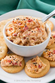 With ample seasonings and just a little kick, creamy Southern pimento cheese is great with everything from crackers or burgers to crab cakes or grits! This cheddar cheese spread also makes a great cold party appetizer dip that doesn't require the oven. Cold Party Appetizers, Appetizer Dips, Appetizer Recipes, Easter Appetizers, Yummy Appetizers, Snack Recipes, Pimento Cheese Recipes, Pimiento Cheese, Cheddar Cheese