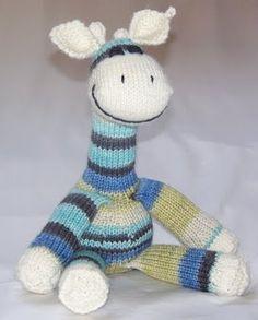 Knit giraffe toy in self striping yarn. Very cute! Free pattern.