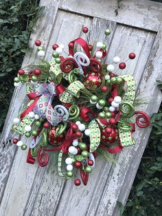 Whimsical Christmas Wreath, Traditional Christmas Wreath, Christmas Wreath, Holiday Wreath, Christmas Fireplace Wreath, Christmas Wreath for Front door Size 27x27x10 Created on a Christmas Greenery base with wire hanger attached. This whimsical Christmas wreath will surely welcome all your