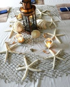Top Nautical Tablescape Idea with Decorative Fish Net: http://www.completely-coastal.com/2012/11/top-tablescape-idea-nautical.html