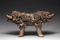 Power Figure (Nkisi N'Kondi: Kozo) Date: 19th century Geography: Democratic Republic of the Congo, Chiloango River region; Cabinda, Angola; Republic of the Congo Culture: Kongo peoples; Yombe group Medium: Wood, metal, resin, plant fiber, textile, pigment