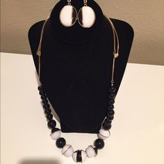 Bundled necklace and earring set Add to your next outfit!! Gorgeous necklace and earring set. Black, white, and gold hardware. NWT Charming Charlie Jewelry Necklaces