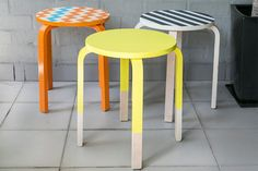 DIY painted stools with either chevron, stripe, or neon with leg detail