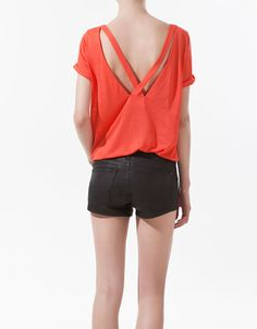 Zara's t-shirt in a coral with crossover back. Cute and comfortable for summer.