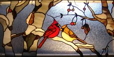Stained glass birds cardinal pair in birch tree