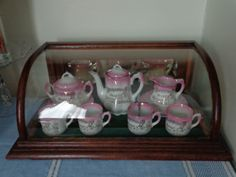 Antique German Pink Lustre Child's Christmas Tea Set w/Santa in a Small Bow Front Store Display Case.
