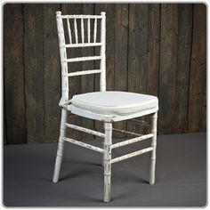 Distressed White Chiavari Chair  -- Shown with a tie-on chair pad available in black, white and ivory - order separately. Micro suede or Topaz seat pad covers also available separately.