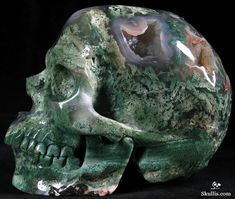 Green Moss Agate Crystal Skull - Wow, amazing  piece of moss agate & carving.