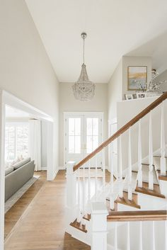 Sea Salt walls by Benjamin Moore w/ white trim.  White & almost white - makes me think of New England homes.