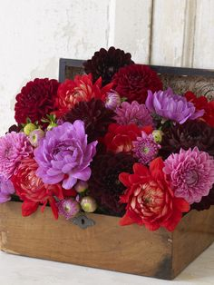 #DIYWedding Centerpiece Themes:  Box of Jewels...Jewel dahlias' intricate petals and intense colors shine like gems in an old jewelry box, while the mix of buds, semi-open and fully open blooms add interest and texture.