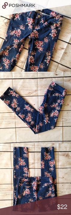 """Aeropostale Floral Printed Skinny Jeans Adorable! Blue stretch skinnies with feminine floral prints. Style is """"Ashley Ultra Skinny"""". By Aeropostale. Size 0. 98% cotton 2% spandex. Waist measures 28-30"""". Rise 6.5"""". Inseam 30"""". Good pre-owned condition with no holes, rips, or stains.  KWs: boho chic, aero, Jeggings, girly girl, summer, weekend warrior, preppy, stretch, stretchy, trendy Aeropostale Jeans Skinny"""