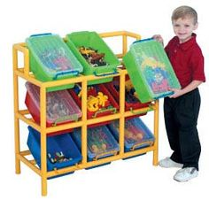 """Storage unit includes pipe for rack and 9 bins. Some assembly required. 33""""L x 15""""W x 33""""H"""