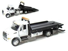 JADA 1/24 International Flatbed Tow Truck - WHITE CAB . $29.95. 1/24 diecast. Aprox 12 inches long, bed slides and tilts, cab doors open.