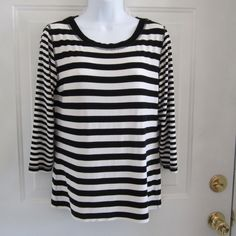 Chico's Travelers Top Black and White Chico Travelers Top Size 1- great for the suitcase...price is firm Chico's Tops