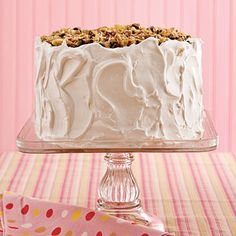 Lane Cake | Pecans, raisings, flaked coconut, and of course, a little bourbon, top this classic Southern layer cake. (Favorite Cake Pecans)