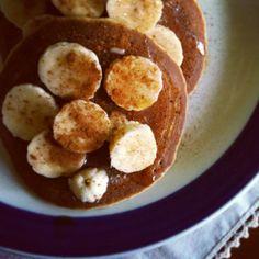 Buckwheat pancakes topped with macadamia nut butter, banana, maple syrup & cinnamon.