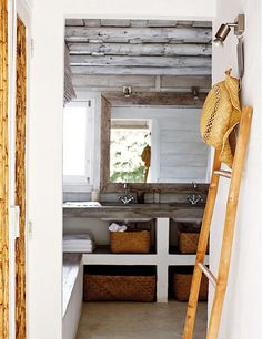 open bathroom shelves w/ woven baskets