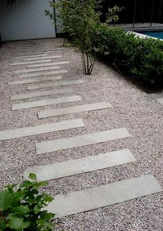 Slaps as stepping stones laid out in a modern way. Nice for a front garden or small court yard.