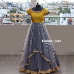 Beautiful gray and mustard yellow color combination floor length dress with floral design ahnd embroidery gold trhead work on yoke. This out fit is Available at 8000 from house of Kadhambari.They can customize the colour and size as per your requirem Long Gown Dress, Lehnga Dress, Frock Dress, Long Frock, Long Gowns, Lehenga Choli, Lehenga Designs, Half Saree Designs, Kurta Designs