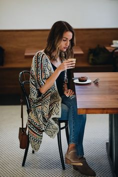 Lauren Kay Sims styles Sole Society's Aztec printed sweater kimono, Nikkie braided suede bootie and Destin cognac crossbody bag