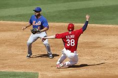 Pete Kozma steals second base ahead of the throw to Anthony Seratelli of the New York Mets during a spring training game. Cards won 7-1.  3-02-14