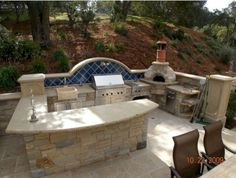 Outdoor Kitchen Designs Featuring Pizza Ovens, Fireplaces And Other Cool Accesso. - Outdoor Kitchen Bars about you searching for. Outdoor Kitchen Countertops, Outdoor Kitchen Bars, Backyard Kitchen, Outdoor Kitchen Design, Backyard Patio, Outdoor Kitchens, Patio Grill, Kitchen Grill, Outdoor Rooms
