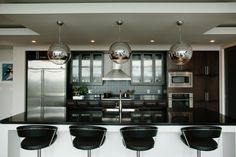 This contemporary kitchen in the Adelicia is perfect for entertaining guests.