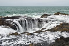 Thor's Well, Oregon  Be warned when staring into the intense and powerful beauty that is Thor's Well in Cape Perpetua, you may just get sucked in if you're not too careful. Though from afar this may look like your run-of-the-mill salt water fountain, accessing it for a good photo-op is actually very dangerous. Think Calypso-dangerous.