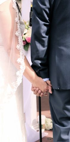 My brother holding his wife's hand.
