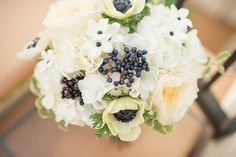 Bridal bouquet of hydrangea, blue viburnum berry and anemone